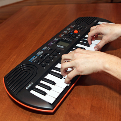 CASIO<sup>&reg;</sup> Mini Keyboard with LCD Screen – Forty-four-key mini keyboard with LCD Screen includes 100 tones and 50 accompaniment patterns.  Learn to play with 10 demo songs!